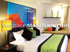 Beachfront Villa Bedroom at Angsana Velavaru Maldives