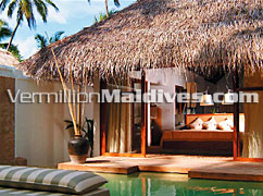 Interior at Coco Palm Bodu Hithi. Maldives Deluxe Accommodations