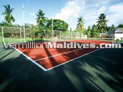 Tennis court surrounded by the lush vegetation: Maldives Village Equator