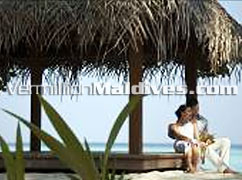 Couple at bale: Four Seasons Landaa Giraaavaru-Maldives Luxury Honeymoon Hotels