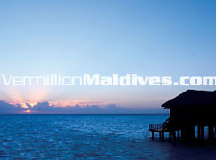 Sunset over the Infinity Water Villas on Maldives Resort Hotel Hilton Irufushi