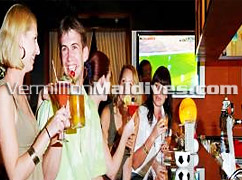 Enjoy a drink in the Hulhule Island Hotel's bar – The airport Hotel