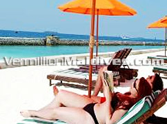 Laze out in the sun during your stay in Hulhule Island Hotel