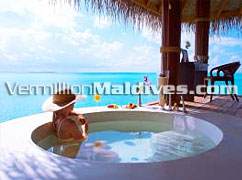 Bath under the clear blue skies of Maldives at the Luxury Resorts Island Hideaway