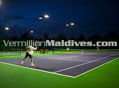Playing Tennis in J Resort Handhufushi. Tennis court for your happiness