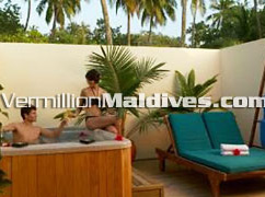 Maldives Hotel Handhufushi at Herathera Island Couple in Jacuzzi a Jacuzzi Beach Villa