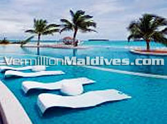 Poolside sun chairs in shallow area of the pool – Beautiful & luxury Maldives hotel