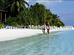 A walk on the beach of Komandoo Maldives Resort & Hotel