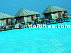 Swimming in the lagoon of Komandoo Resort Maldives