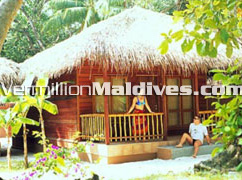 Maldivian style, tropical accommodations at hotel Kuramathi Maldives