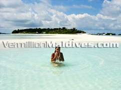 A nice Maldives picture with crystal clear water and the sandy beach of the island