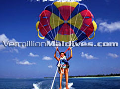 Parasailing in Paradise Maldives. Have fun & enjoy your vacation here