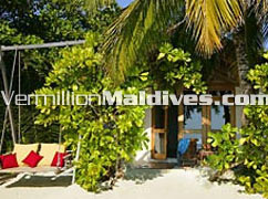 Deluxe Villa Accommodation with the swing at Reethibeach resort Maldives