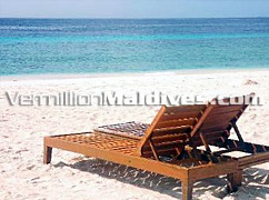Sun Chairs and Sunbathing in Tropical Resort Hotel Vivanta Corel Reef by Taj Maldives